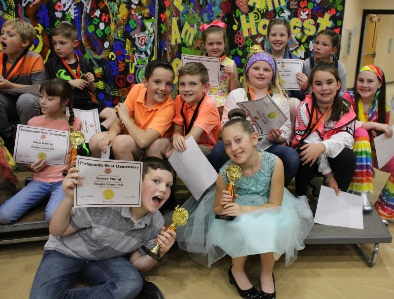 Third grade students with their certificates