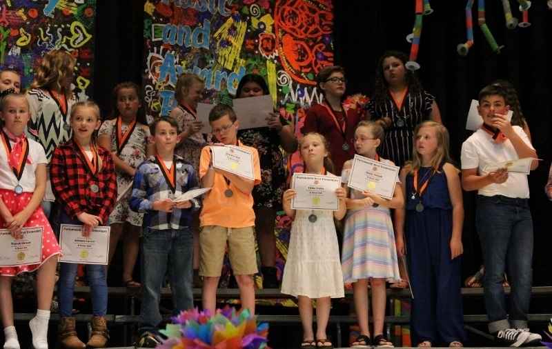 4th grade students with their awards.